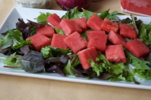 Fill platter with lettuce(I used baby field greens) before topping with a layer of watermelon chunks.